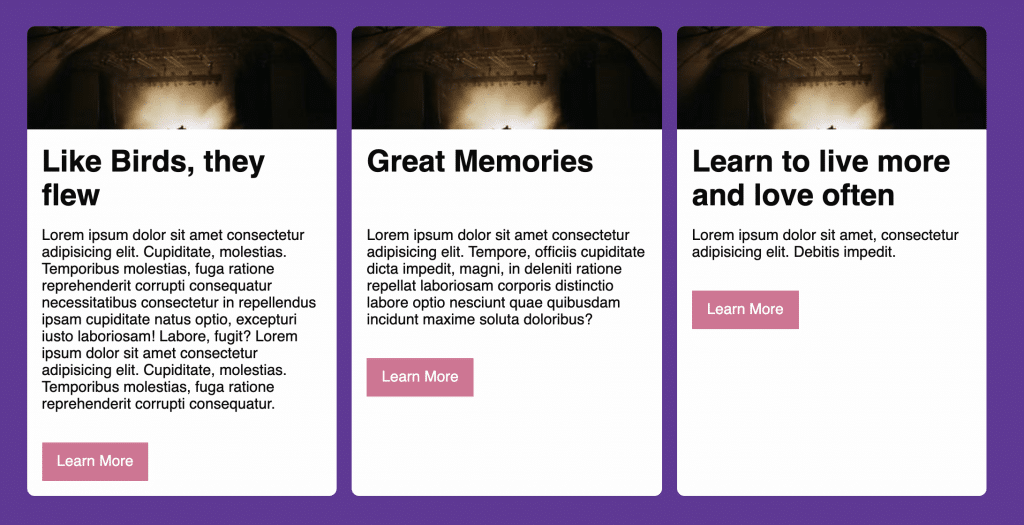 Row of three columns arranged with flexbox, each with containing a card with an image, headline, text, and a button. The text is a different length in each card with the buttons immediately after the text.